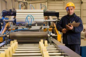 14287467 - factory worker processing roll of steel sheet