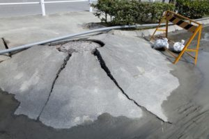 42567617 - manhole, which was raised in the liquefaction phenomenon